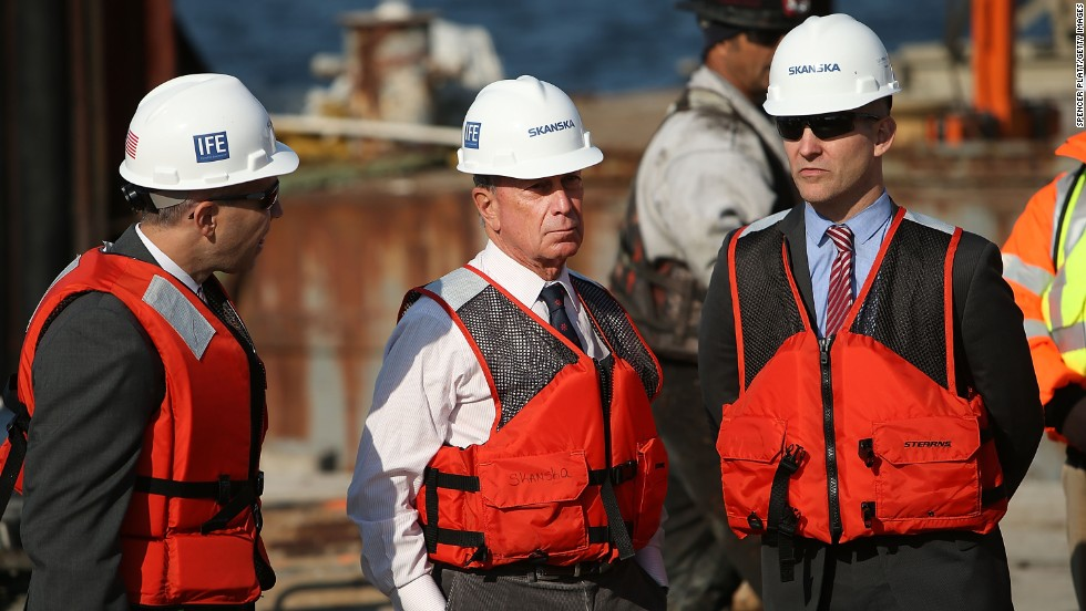 In October, on the one-year anniversary of Hurricane Sandy, Bloomberg, center, stands on a rig installing a new sea wall in the Rockaways.