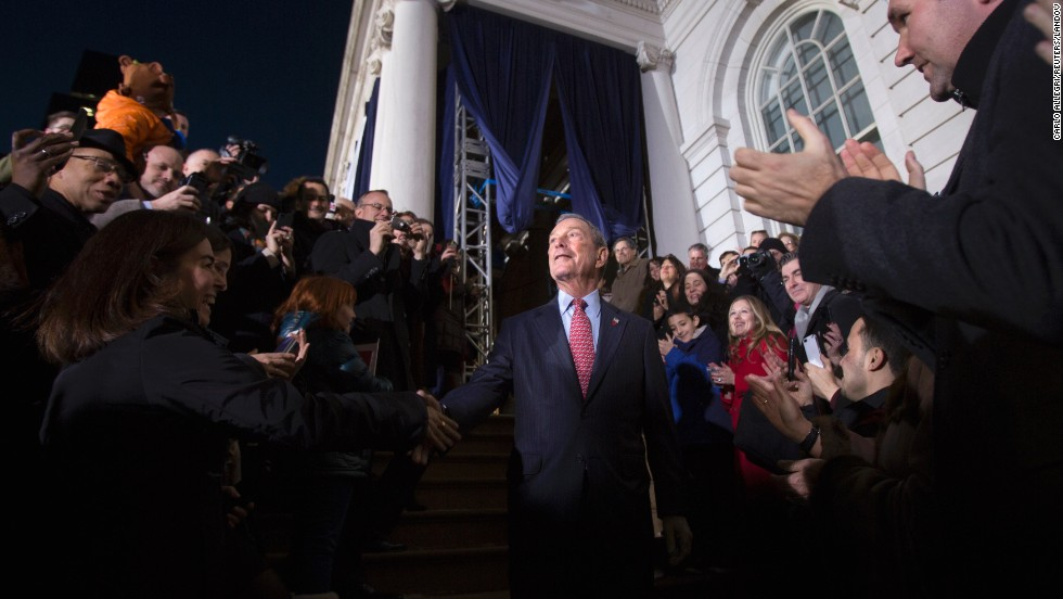 Bloomberg walks through the crowd outside City Hall as he leaves for the last time as mayor.