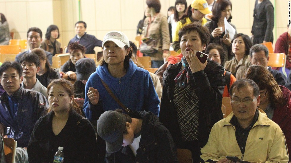 Parents at Danwon High School search for names of their children among the list of survivors. Ansan is a suburb of Seoul, the South Korean capital.