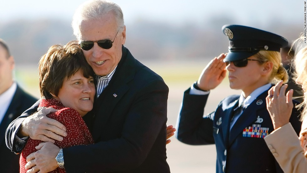 Biden hugs Anne Holton, wife of U.S. Sen. Tim Kaine, on a tarmac in Roanoke, Virginia, in November 2012.