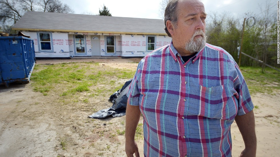 John Raimer stands in front of a house in West, Texas, that was built by 60 volunteers from Oklahoma and Arkansas. Raimer is the construction chief for the West Long-Term Recovery Center.