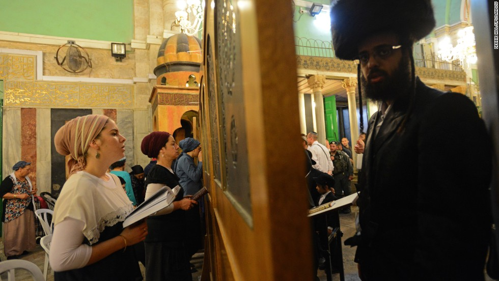A barrier separates men and women as they pray in the Cave of Machpelah, or Cave of the Patriarchs, in Hebron, West Bank, on Wednesday, April 16. The Cave of Machpelah is the burial site that the biblical patriarch Abraham purchased for his family.