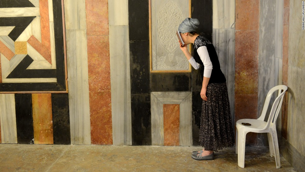 A woman prays in the Cave of Machpelah on April 16.