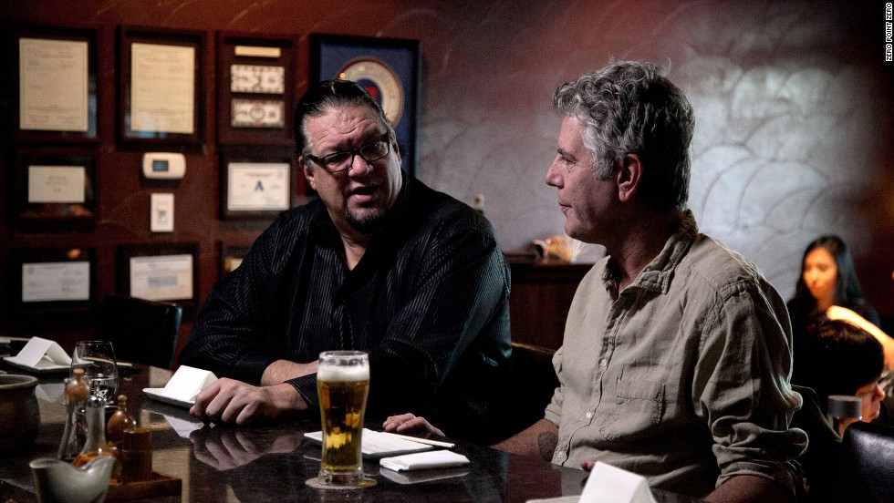 Bourdain talks with author and magician Penn Jillette at Raku, a Japanese restaurant in Las Vegas.