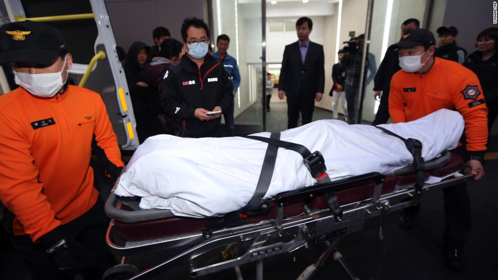 The body of a victim is moved at a hospital in Mokpo on April 17.