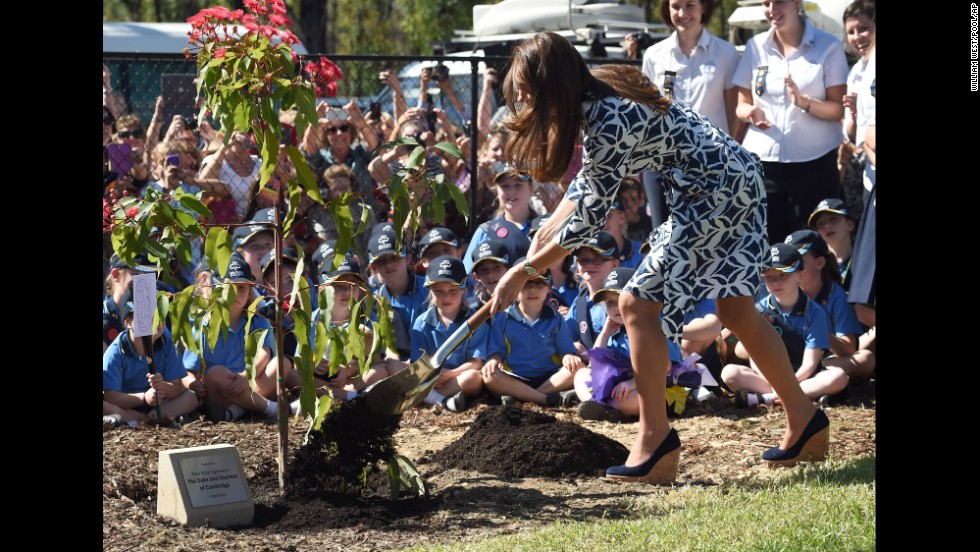 Catherine shovels dirt at the tree planting in Winmalee on April 17.