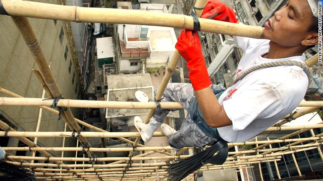 Hong Kong's scaffolders dangle precariously on bits of bamboo.