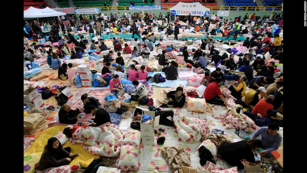 Family members of passengers aboard the sunken ferry gather at a gymnasium in Jindo on April 17.