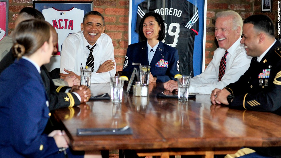 Obama and Biden have lunch with active duty service members at a Washington restaurant in November.