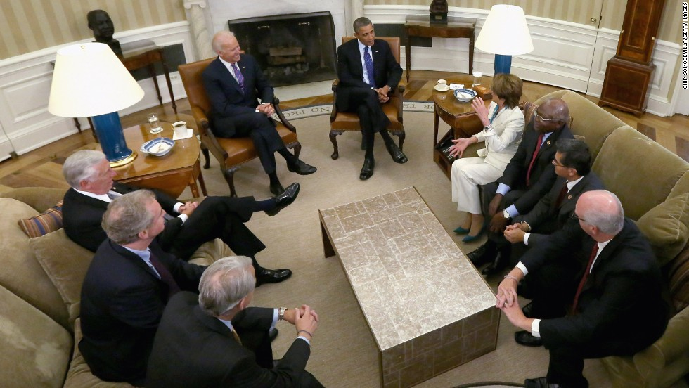 Obama and Biden meet with House Democratic leaders in the Oval Office of the White House in October.