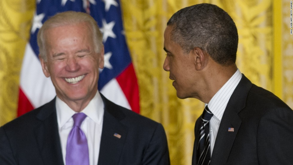 Biden laughs at the White House in June.