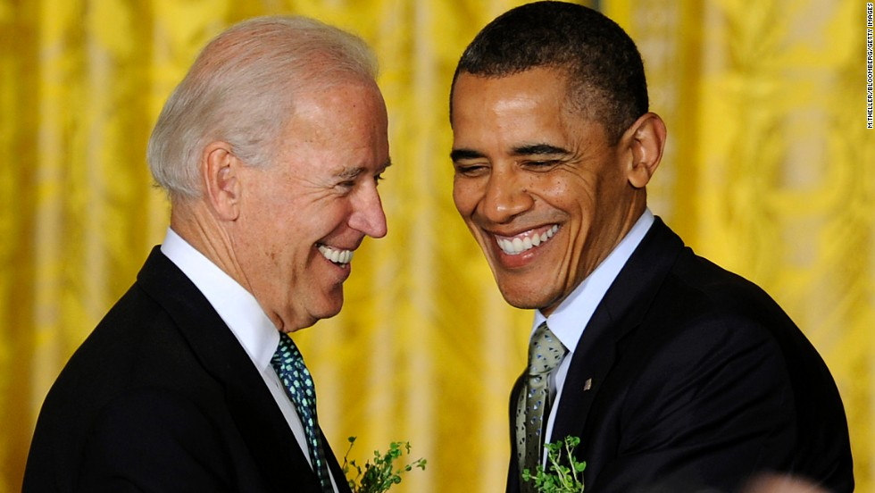 Biden and Obama shake hands at a White House reception in March 2012.