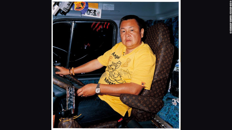 "Because of his background working with trucks, Masaru had a natural affinity with the drivers. He developed genuine relationships with them, and still keeps in contact with many of his subjects. ""It might be difficult to just go up to them and meet them,"" he says. ""I attended their meetings and earned their trust. Then they were willing to cooperate."" Among the drivers is Mr. Itakura, seen above with his Louis Vuitton-inspired upholstery."