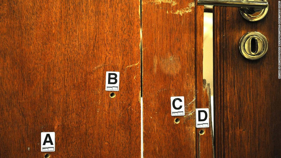 """The door through which Oscar Pistorius fatally shot his girlfriend, Reeva Steenkamp, is used as evidence during <a href=""""http://www.cnn.com/2014/03/03/africa/gallery/pistorius-2014-trial/index.html"""">his murder trial</a> Monday, April 14, in Pretoria, South Africa. Pistorius, the first double amputee runner to compete in the Olympics, is accused of intentionally killing Steenkamp in February 2013. He has pleaded not guilty to murder and three weapons charges."""