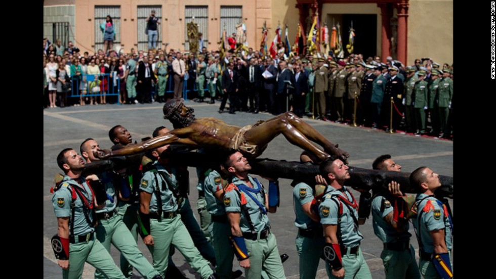 Members of the Spanish Legion carry a statue of Christ of Mena on April 17 in Malaga, Spain.