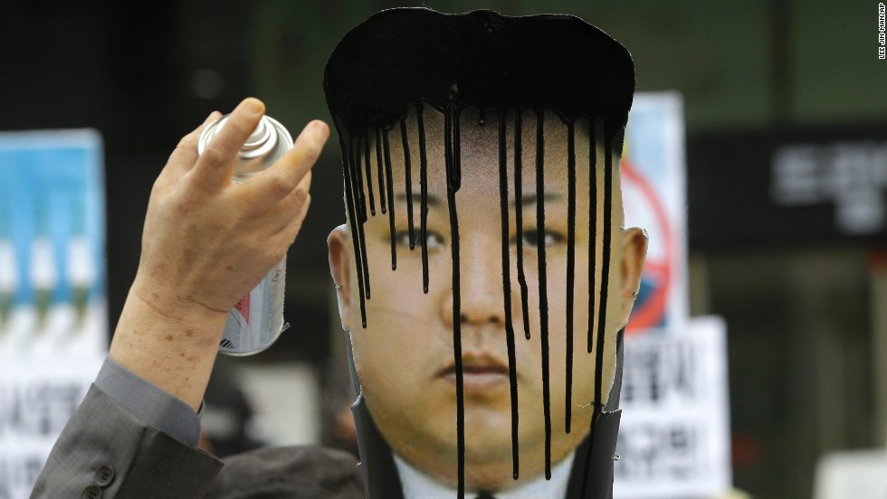 A picture of North Korean leader Kim Jong Un is sprayed by a protester during an anti-North Korea rally Tuesday, April 15, in Seoul, South Korea.