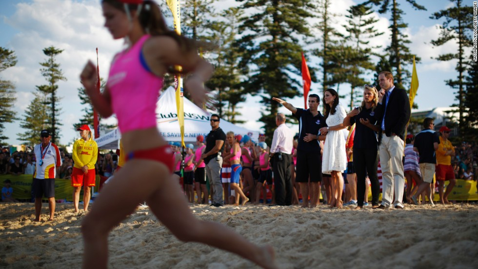 The royal couple watches a beach sprint race with Australian surf lifesavers on Manly Beach on April 18.