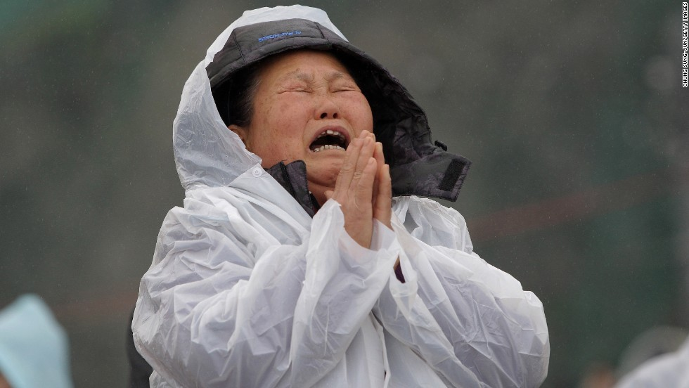 A woman cries as she waits for news on missing passengers April 18 in Jindo.