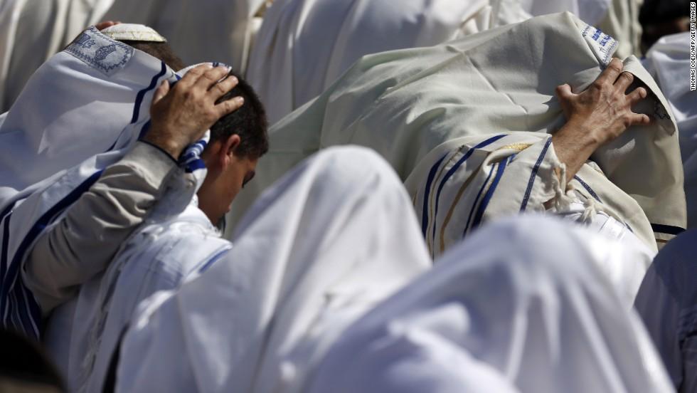 Jewish men draped in prayer shawls perform the Cohanim prayer at the Western Wall on April 17.
