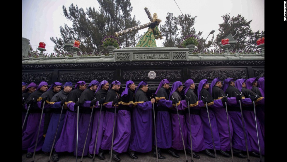 Catholics participate in a procession as part of Good Friday activities in Guatemala City, Guatemala, on April 18.