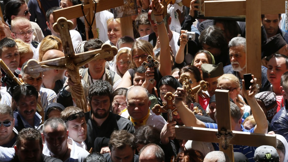 Christian Orthodox pilgrims carry wooden crosses during a Good Friday procession in Jerusalem.