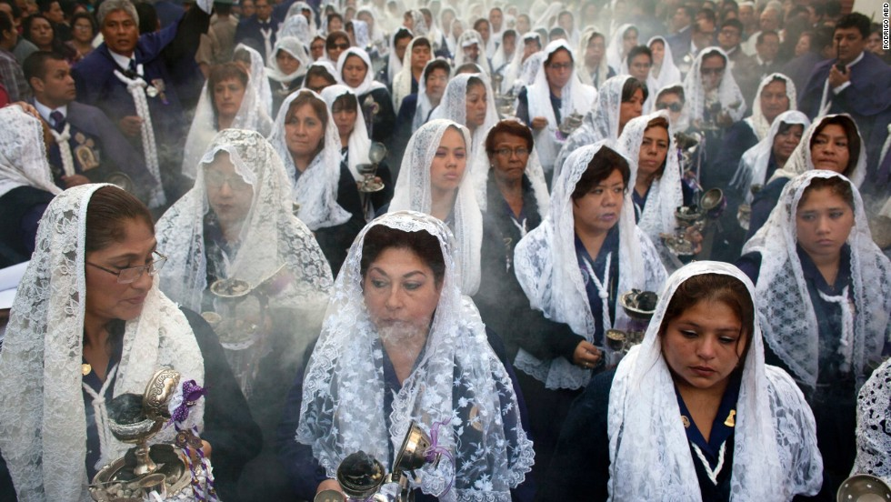 Women burn incense while participating in a Good Friday procession honoring the patron saint of Lima, Peru, on April 18.