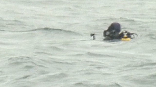Divers see bodies in sunken ferry
