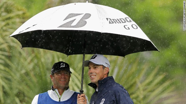 Matt Kuchar takes cover under an umbrella at the RBC Heritage in South Carolina.