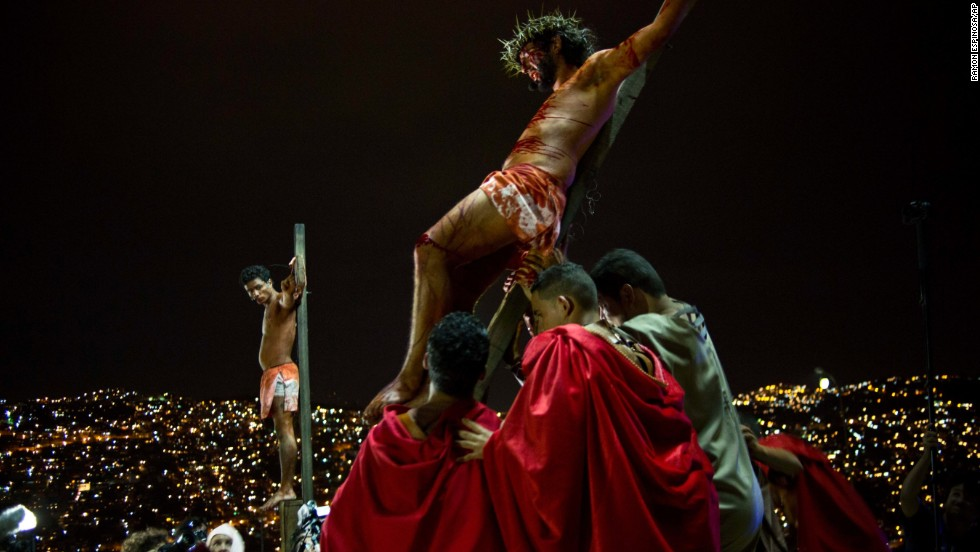Residents re-enact Jesus Christ's crucifixion on a hilltop in the Petare shanty town during Holy Week in Caracas, Venezuela, on Friday, April 18.