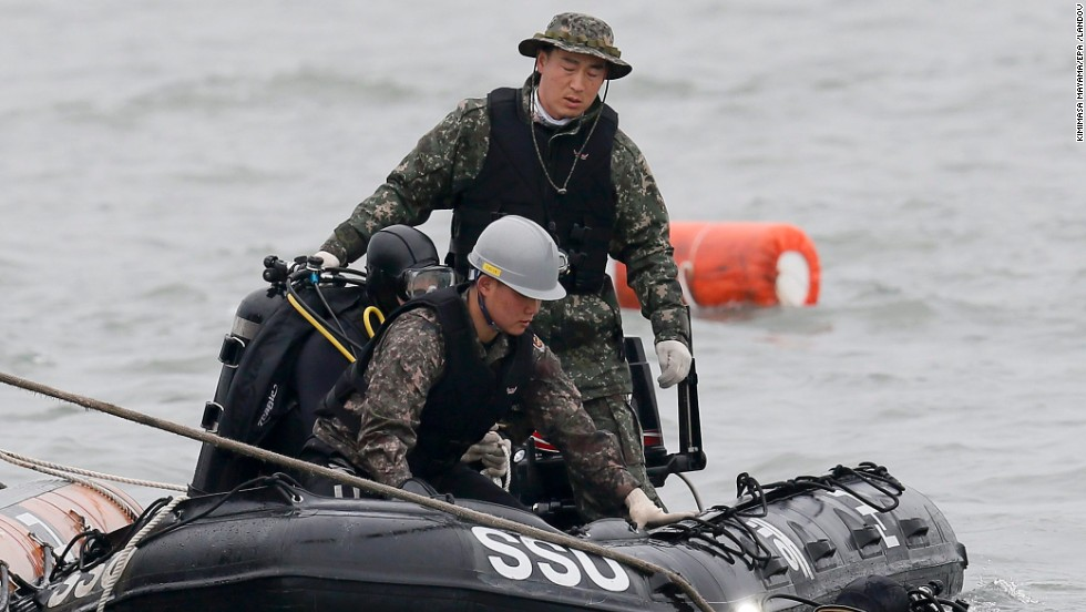 South Korean Navy Ship Salvage Unit members prepare to salvage the sunken ferry and search for missing people on April 19.