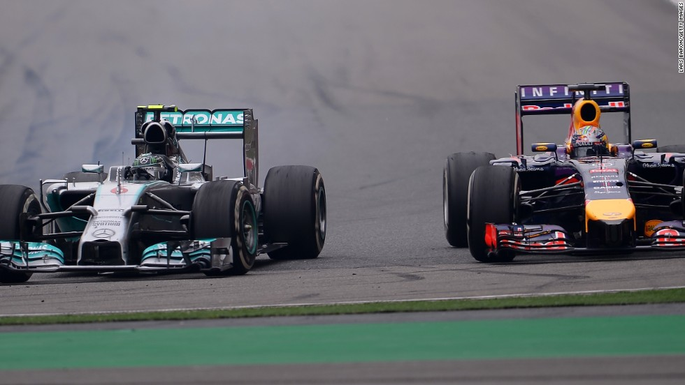 Nico Rosberg in his Mercedes sweeps past Sebastian Vettel as he works his way through the field after a poor start in Shanghai.