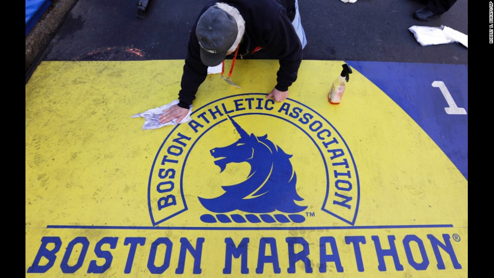 A man cleans the finish line on Boylston Street in downtown Boston before the marathon.