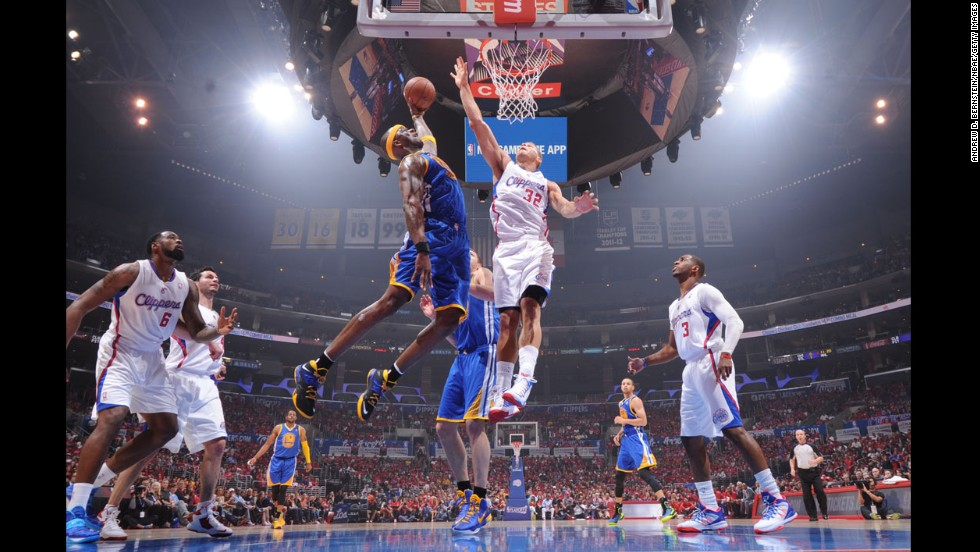 Golden State Warriors player Jermaine O'Neal shoots against Blake Griffin of the Los Angeles Clippers during game one of the Western Conference Quarterfinals during the NBA Playoffs on April 19 in Los Angeles.