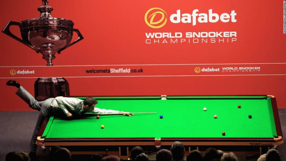 England's Mark Selby plays Michael White of Wales during day four of the the Dafabet World Championship at Crucible Theater on April 21 in Sheffield, England.