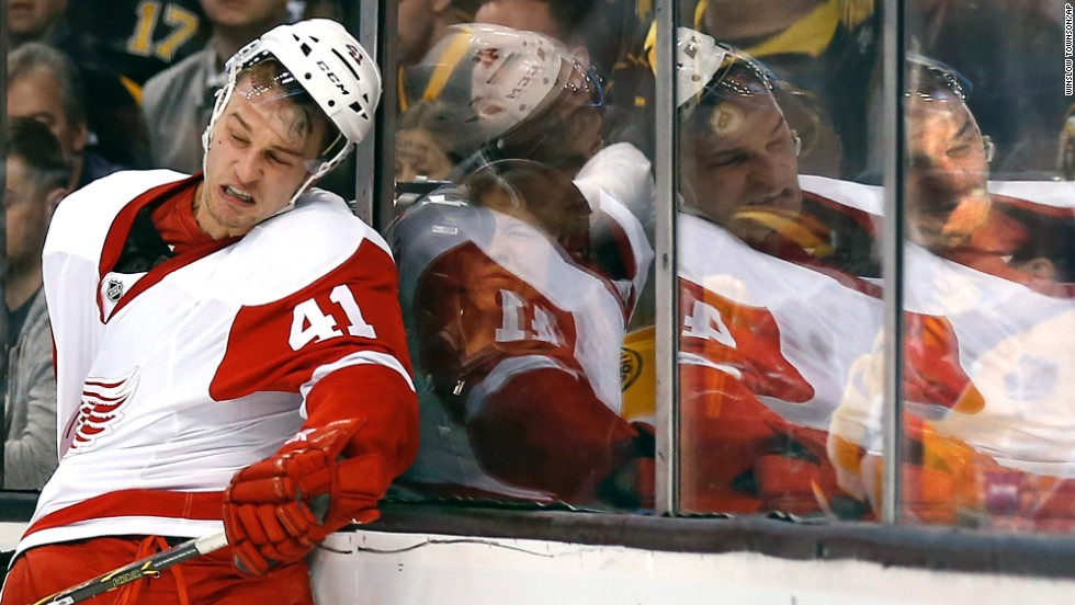 Detroit Red Wings' Luke Glendening gets knocked into the glass during a first-round NHL hockey playoff series against the Boston Bruins in Boston on April 20. The Bruins beat the Red Wings 4-1.