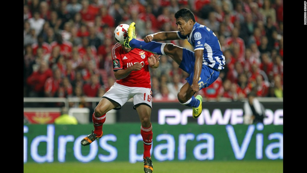 Benfica's Eduardo Salvio, left, heads the ball to score the opening goal past Porto's Alex Sandro during a Portugal Cup semifinal second leg soccer match in Lisbon on April 16.