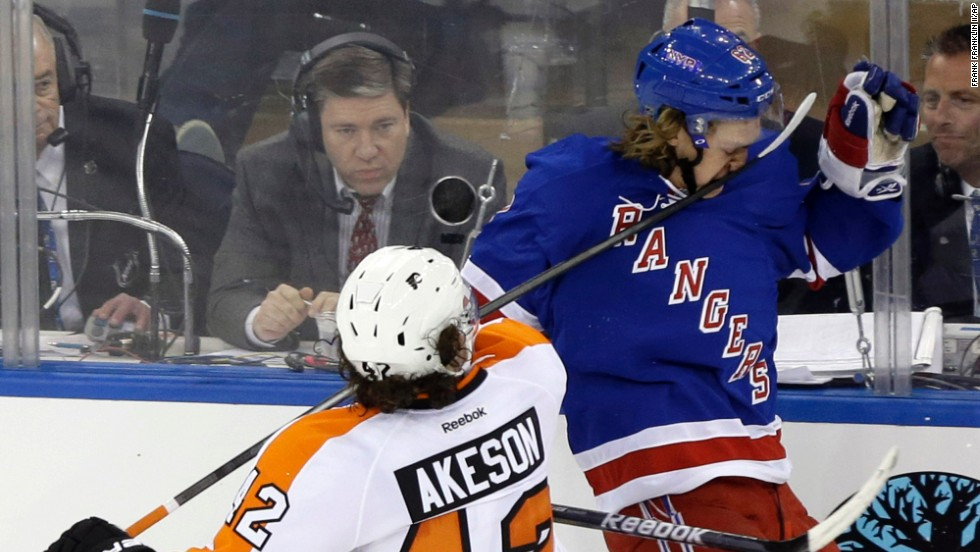Philadelphia Flyers' Jason Akeson hits New York Rangers' Carl Hagelin in the face with his stick during a first-round playoff series on April 17 in New York. Akeson was penalized on the play. The Rangers won the game 4-1.