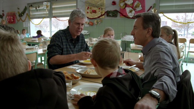 Tony breaks bread with second graders