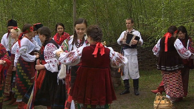 Ukrainian dancers smile, but worry