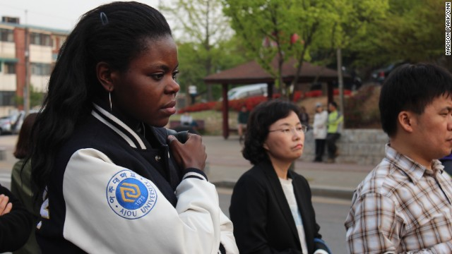 Judith Ambe grieves for friends missing after the Sewol incident at Danwon High School in Ansan, South Korea.