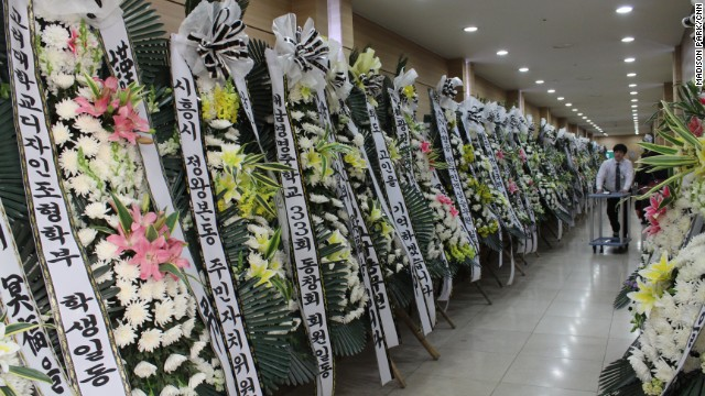 Flowers for Sewol crew member Jee Young Park pack a hallway at the funeral hall in Incheon, South Korea.