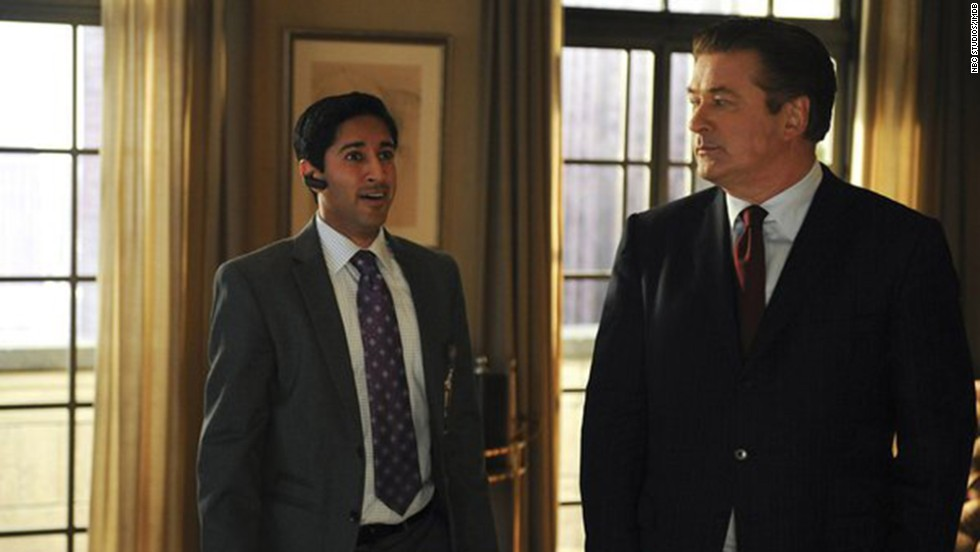 "Jack Donaghy, right, meets with his executive assistant, Jonathan, in NBC's ""30 Rock.""  Jonathan often goes beyond the call of duty, like the time he drove around Pennsylvania in search of a program from a high school play so Jack could give Liz Lemon the perfect Christmas gift. And of course, even when Jack's job changes, Jonathan follows."