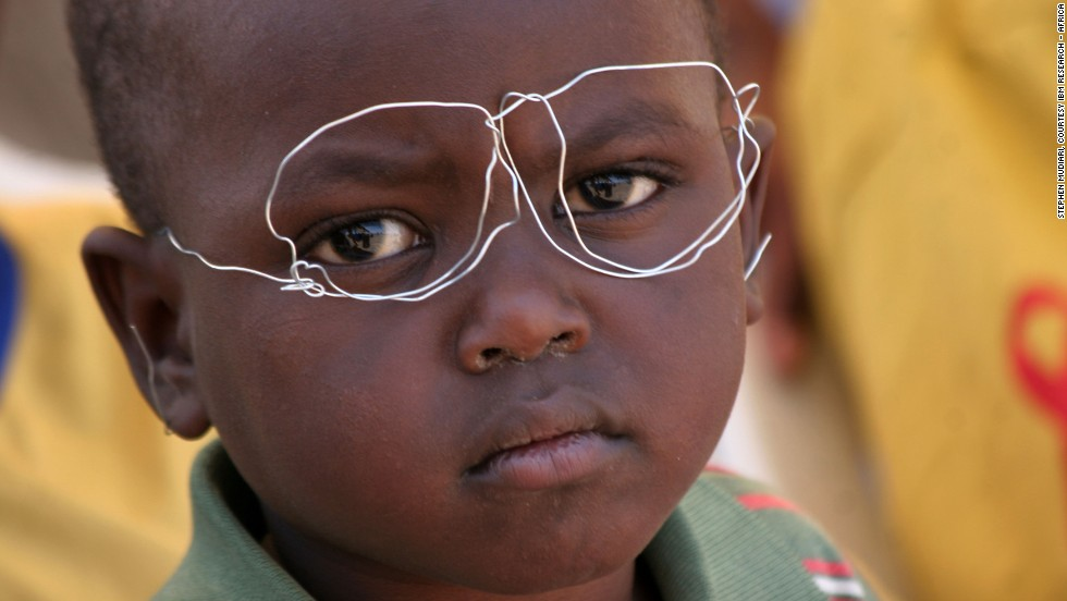 "In ""Creative Minds,"" five-year old Ken Kyalo wears a pair of glasses he fashioned from scrap wire during the laying of the foundation stone for a new building at the Heritage of Hope and Faith Children's Rehabilitation Center in Mlolongo, Kenya."