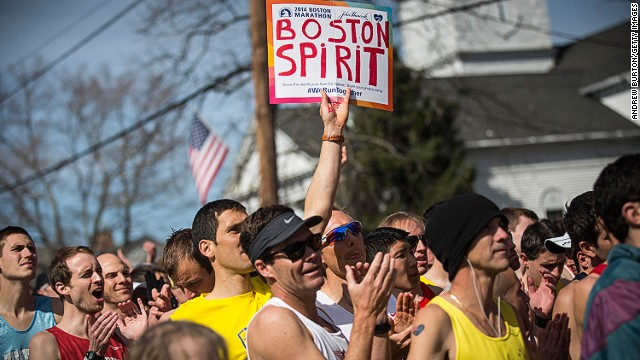 Runners wait for the start gun at the beginning of the Boston Marathon on April 21, 2014 in Hopkington, Massachusetts. Today marks the 118th Boston Marathon; security presence has been increased this year, due to two bombs that were detonated at the finish line last year, killing three people and injuring more than 260 others.