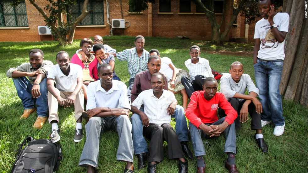 Twenty-three-year-old Jean Clude Nkusi (bottom left) has been elected as the father of the Urumuri family, which numbers 24 children -- some of them are pictured here at the University of Rwanda College of Education in Kigali.