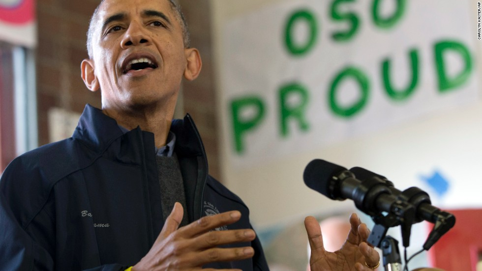 President Obama speaks to first responders, recovery workers and community members on Tuesday, April 22, at the scene of the deadly landslide that devastated Oso, Washington, one month before. The landslide crossed the North Fork of the Stillaguamish River and caused multiple deaths and massive damage.