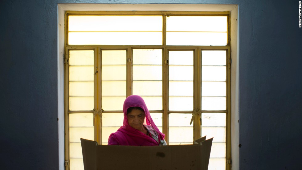 A woman casts her vote on the outskirts of Jaipur, India, on Thursday, April 17.
