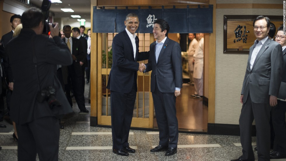 Abe greets Obama before dinner.