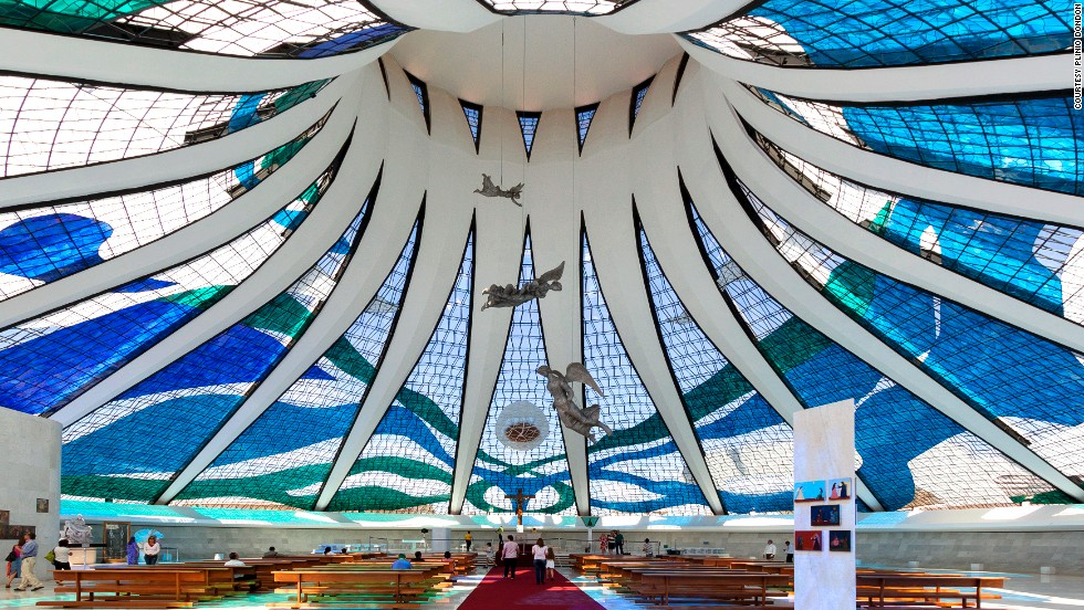 "<strong>Cathedral of Brasilia</strong><br />Another marvel by Oscar Niemeyer, the 40-meter-high Cathedral of Brasilia and its suspended angels are bathed with natural light shining through the stained glass. The circular structure has glass ceilings that start at the floor, supported by 16 curved columns. The cathedral can hold up to 4,000 people.<a href=""http://catedral.org.br/"" target=""_blank""><br />Metropolitan Cathedral of Brasília</a>, Esplanada dos Ministérios, lote 12, Brasília; +55 61 3224 4073"