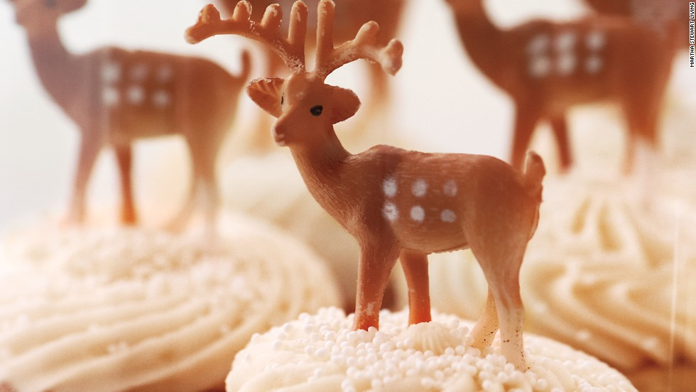 Buttercream cupcakes were another perfect landing spot for miniature deer figurines.